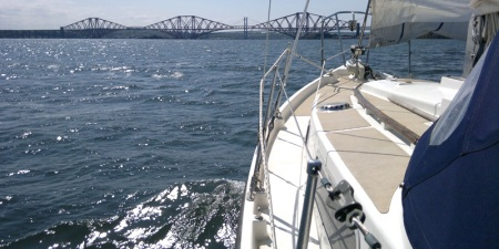 Macwester Malin ketch sailing towards the Forth Bridge